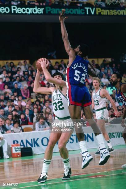 Kevin McHale of the Boston Celtics goes up for a shot against Buck Williams of the New Jersey Nets during a game played in 1986 at the Boston Garden...