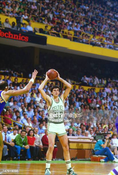 Kevin McHale of the Boston Celtics looks to make a pass against the Los Angeles Lakers during the 1984 NBA Basketball Finals at the Boston Garden in...