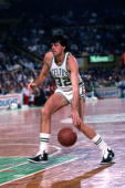 Kevin McHale of the Boston Celtics moves the ball up court during a game played in 1986 at the Boston Garden in Boston Massachusetts NOTE TO USER...