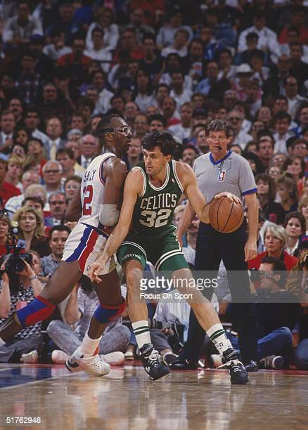 Kevin McHale of the Boston Celtics presses towards the basket against the Detroit Pistons at The Palace of Auburn Hills in 1991 in Auburn Hills...