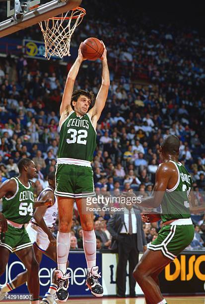 Kevin McHale of the Boston Celtics pulls down a rebound against the Washington Bullets during an NBA basketball game circa 1990 at the Capital Center...