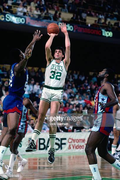 Kevin McHale of the Boston Celtics shoots a jump shot against Buck Williams of the New Jersey Nets during a game played in 1987 at the Boston Garden...