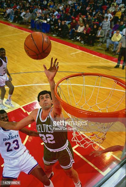 Kevin McHale of the Boston Celtics shoots over Charles Jones of the Washington Bullets during an NBA basketball game circa 1990 at the Capital Center...