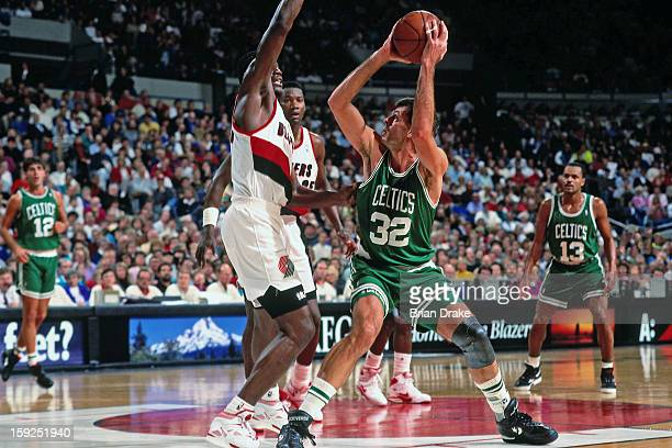 Kevin McHale of the Boston Celtics shoots the ball against the Portland Trail Blazers during a game played at the Veterans Memorial Coliseum in...