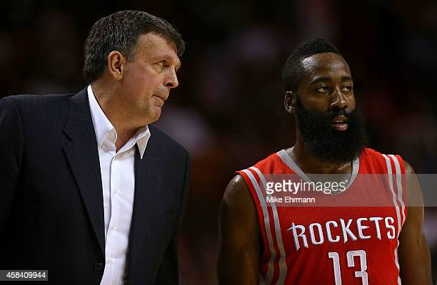 Kevin McHale of the Houston Rockets talks with James Harden during a game against the Miami Heat at American Airlines Arena on November 4 2014 in...