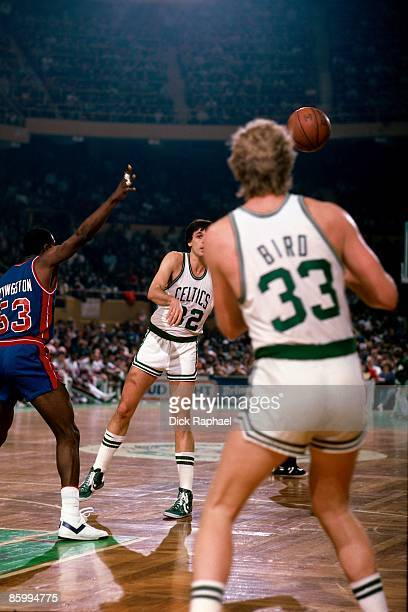 Kevin McHale passes to Larry Bird both of the Boston Celtics against Cliff Levingston of the Detroit Pistons during a game played in 1983 at the...
