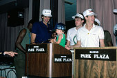 Kevin McHale Rick Carlisle and Danny Ainge of the Boston Celtics along with a player's son at a press conference during the 1986 NBA Finals in Boston...