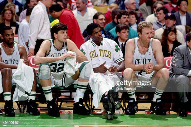 Kevin McHale Robert Parish and Larry Bird sit on the sideline during a game played in 1992 at the Boston Garden in Boston Massachusetts NOTE TO USER...