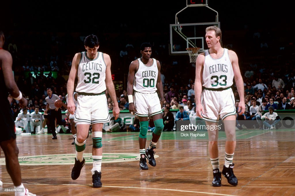 Kevin McHale Robert Parish and Larry Bird stand on the court during a game played in 1992 at the Boston Garden in Boston Massachusetts NOTE TO USER...