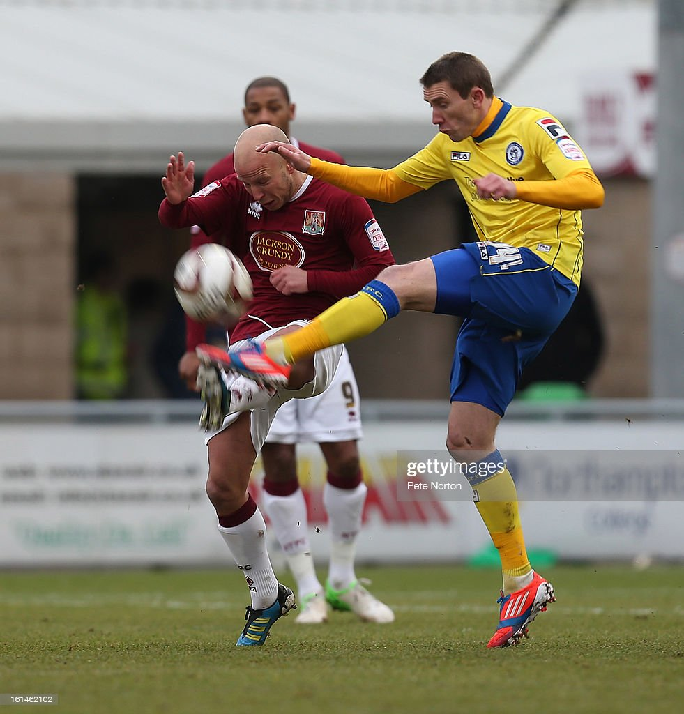 Kevin McIntyre of Rochdale contests the ball with Luke Guttridge of Northampton Town during the npower League Two match between Northampton Town and Rochdale at Sixfields Stadium on February 9, 2013 in Northampton, England.