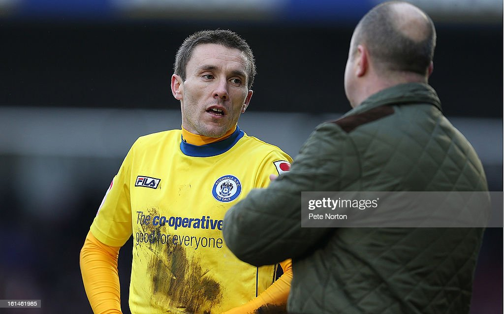 Kevin McIntyre of Rochdale listens to his manager Keith Hill during the npower League Two match between Northampton Town and Rochdale at Sixfields Stadium on February 9, 2013 in Northampton, England.