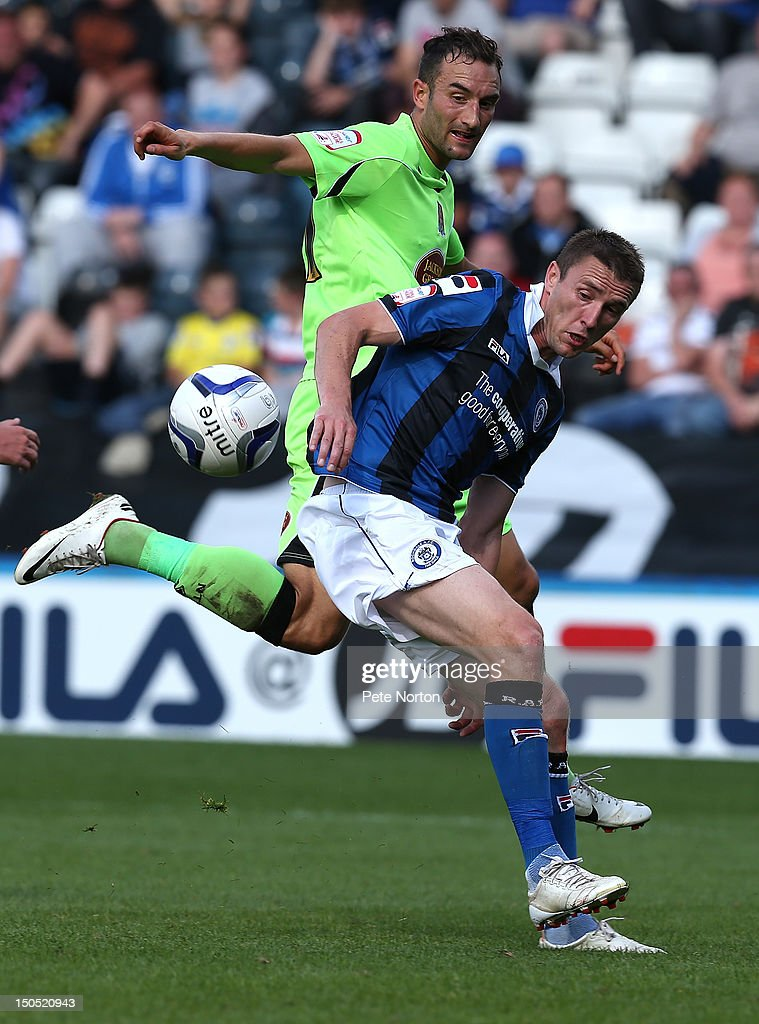 Kevin McIntyre (R) of Rochdale looks for the ball with Chris Hackett of Northampton Town during the npower League Two match between Rochdale and Northampton Town at Spotland Stadium on August 18, 2012 in Rochdale, England.