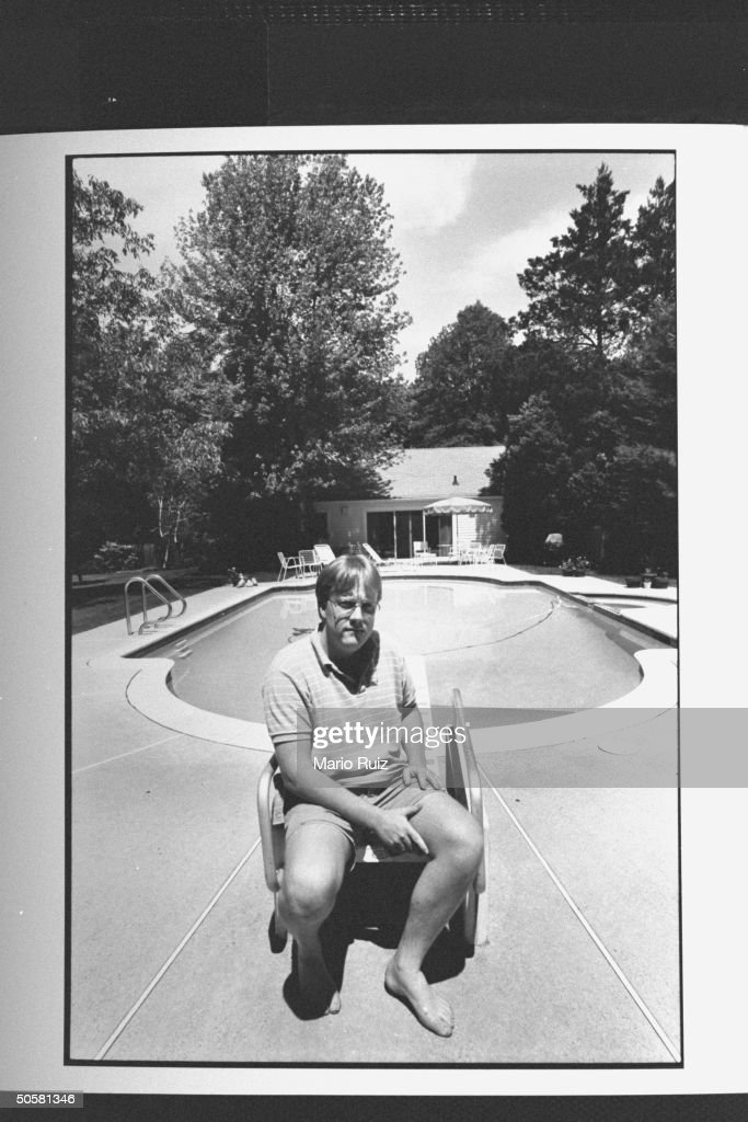 Kevin McLoughlin of 431 Hillside Avenue sitting in front of his pool pool house behind him is a last remnant of the List house where John E List...