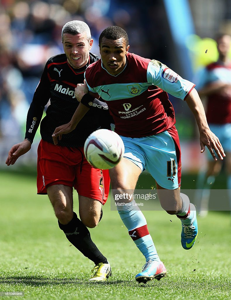 Kevin McNaughton of Cardiff City and Junior Stanislas of Burnley challenge for the ball during the npower Championship match between Burnley and Cardiff City at Turf Moor on April 20, 2013 in Burnley, England.