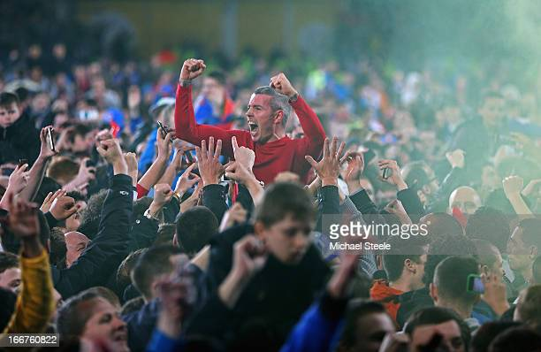 Kevin McNaughton of Cardiff City celebrates with fans at the team's promotion to the Premier League at the end of the npower Championship match...