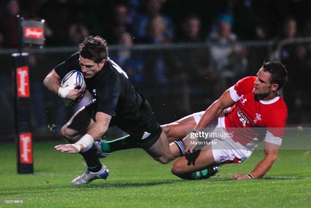 Kevin Mealamu of the All Blacks scores a try in the tackle of <a gi-track='captionPersonalityLinkClicked' href=/galleries/search?phrase=Lee+Byrne&family=editorial&specificpeople=460147 ng-click='$event.stopPropagation()'>Lee Byrne</a> of Wales during a International rugby match at Carisbrook on June 19, 2010 in Dunedin, New Zealand.