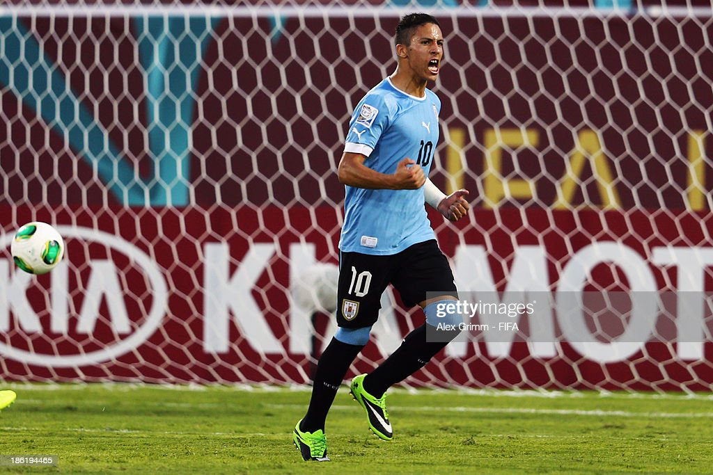 Kevin Mendez of Uruguay celebrates his team's second goal during the FIFA U-17 World Cup UAE 2013 Round of 16 match between Uruguay and Slovakia at Ras Al Khaimah Stadium on October 29, 2013 in Ras al Khaimah, United Arab Emirates.