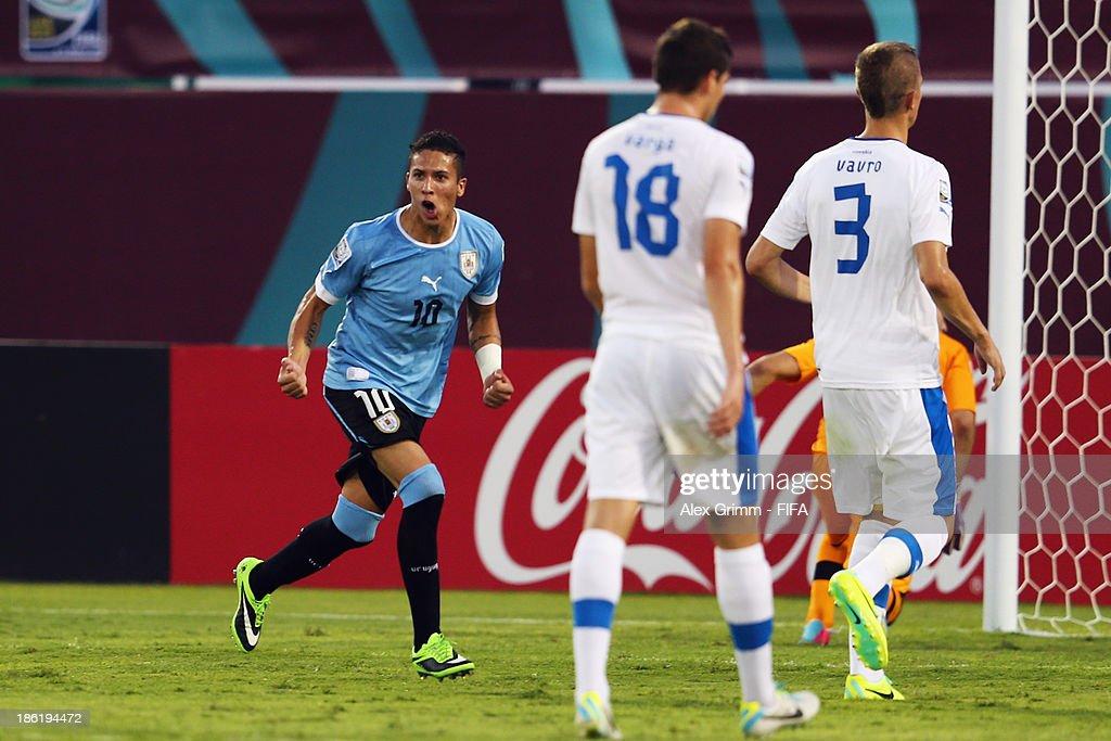 Kevin Mendez of Uruguay celebrates his team's second goal during the FIFA U-17 World Cup UAE 2013 Round of 16 match between Uruguay and Slovakia at Ras Al Khaimah Stadium on October 29, 2013 in Ras al Khaimah, United Arab Emirates.
