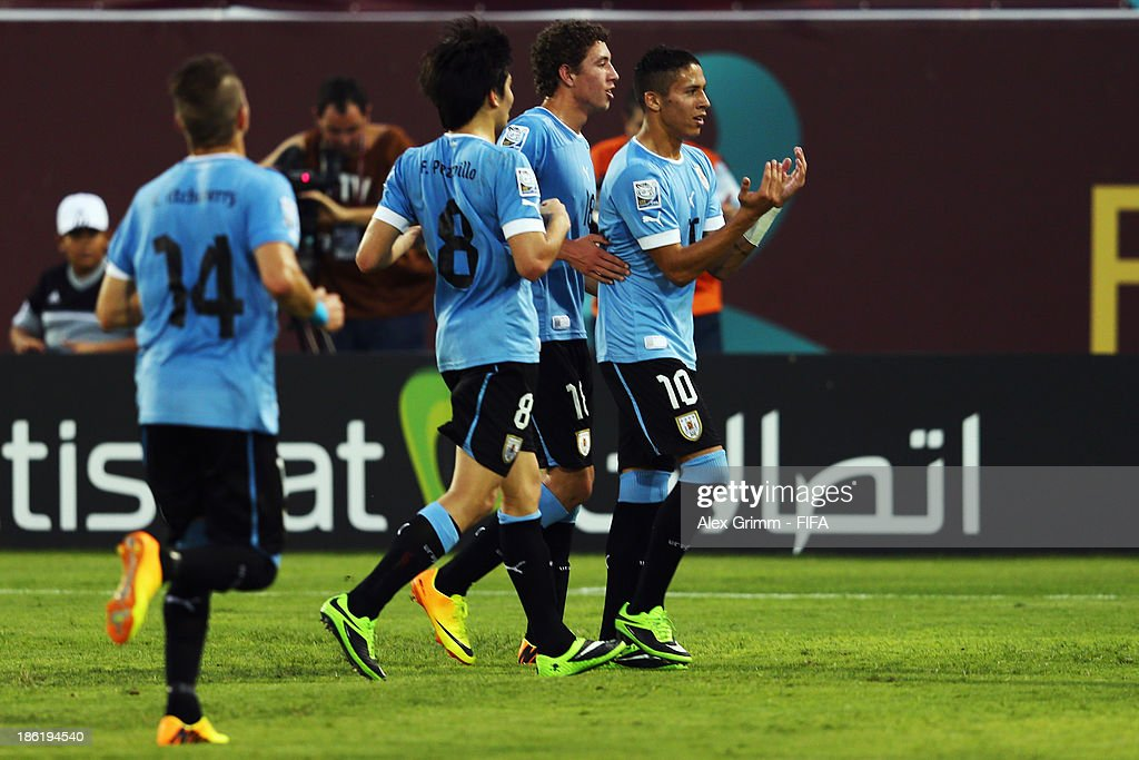 Kevin Mendez (R) of Uruguay celebrates his team's second goal with team mates during the FIFA U-17 World Cup UAE 2013 Round of 16 match between Uruguay and Slovakia at Ras Al Khaimah Stadium on October 29, 2013 in Ras al Khaimah, United Arab Emirates.