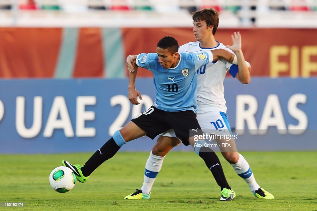 Kevin Mendez (front) of Uruguay is challenged by Jakub Hromada of Slovakia during the FIFA U-17 World Cup UAE 2013 Round of 16 match between Uruguay and Slovakia at Ras Al Khaimah Stadium on October 29, 2013 in Ras al Khaimah, United Arab Emirates.