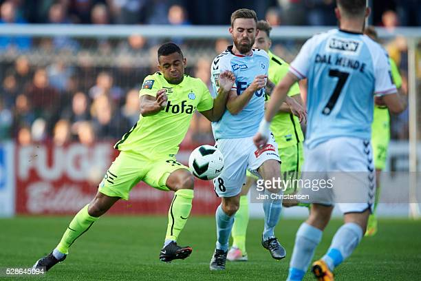 Kevin Mensah of Esbjerg fB and Janus Drachmann of SonderjyskE compete for the ball during the Danish Alka Superliga match between SonderjyskE and...