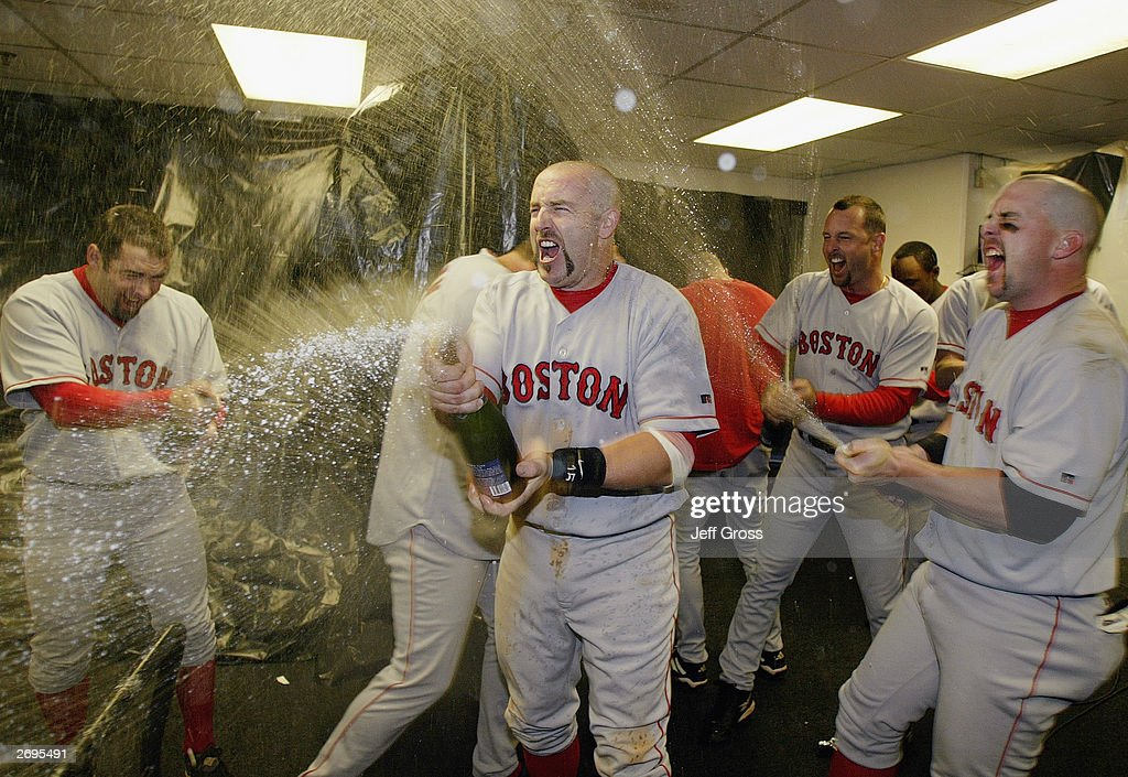 Kevin Millar #15 of the Boston Red Sox celebrates the victory over the Oakland A's in Game 5 of the 2003 American League Divisional Series on October 6, 2003 at Network Associates Coliseum in Oakland, California. The Red Sox defeated the A's 4-3.