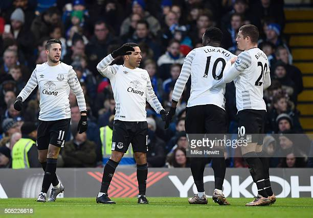 Kevin Mirallas Aaron Lennon Romelu Lukaku and Ross Barkley of Everton celebrate their team's first goal scored by John Terry of Chelsea during the...