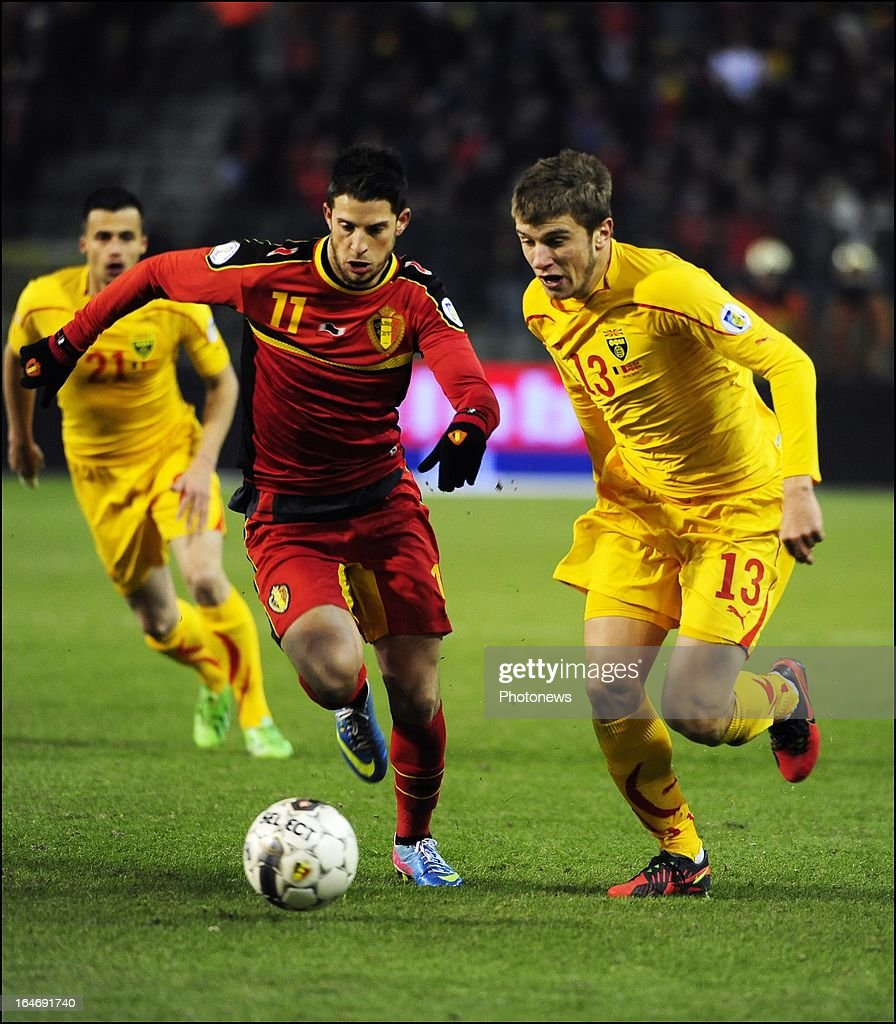 Kevin Mirallas (L) of Belgium and Stefan Ristovski of Macedonia during the FIFA 2014 World Cup Group A qualifying match between Belgium and Macedonia at the King Baudouin stadium on March 26, 2013 in Brussels, Belgium.