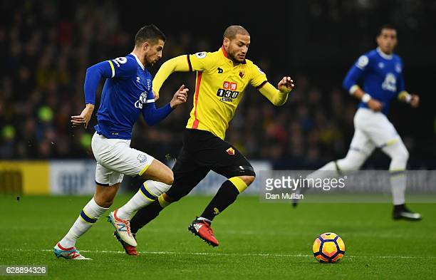 Kevin Mirallas of Everton and Adlene Guedioura of Watford chase the ball during the Premier League match between Watford and Everton at Vicarage Road...