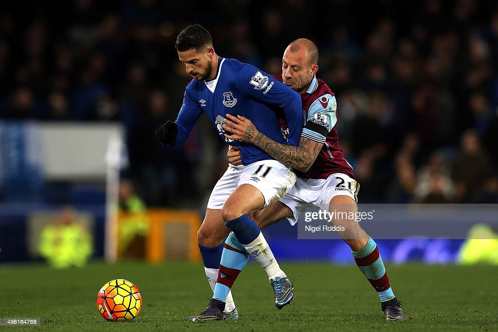 Kevin Mirallas of Everton and Alan Hutton of Aston Villa compete for the ball during the Barclays Premier League match between Everton and Aston Villa at Goodison Park on November 21, 2015 in Liverpool, England.