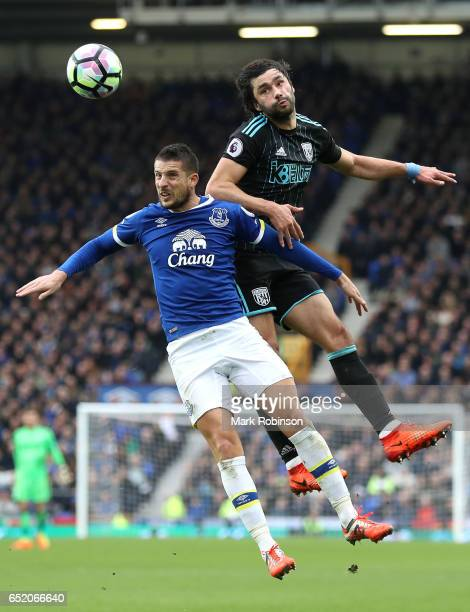 Kevin Mirallas of Everton and Claudio Yacob of West Bromwich Albion battle to win a header during the Premier League match between Everton and West...