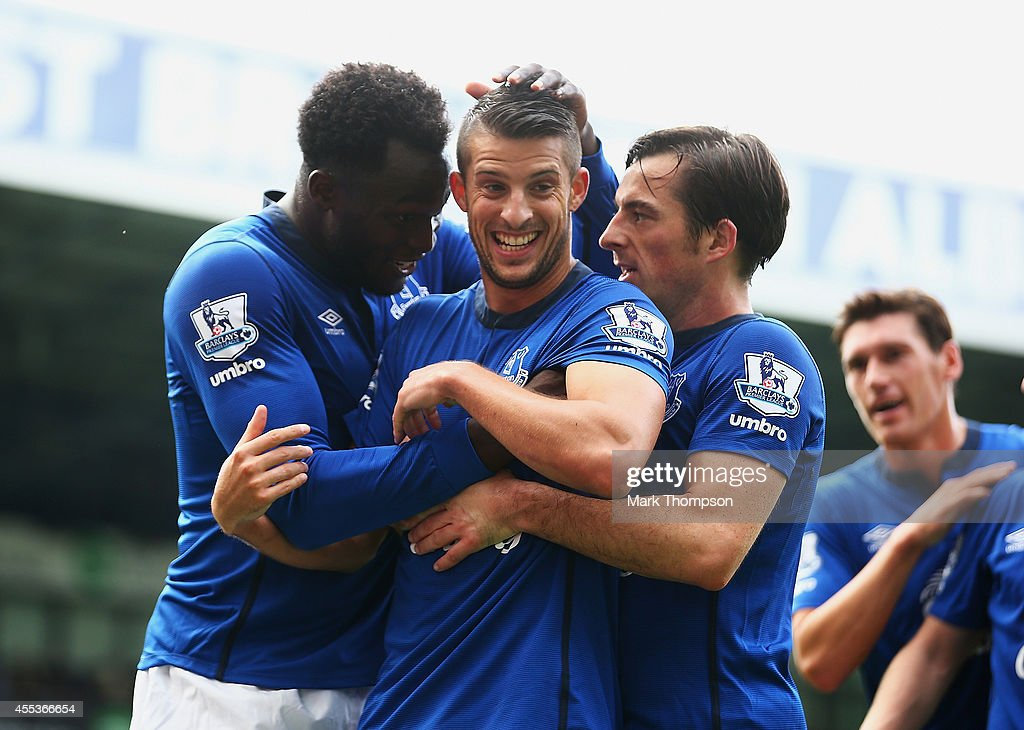 Kevin Mirallas of Everton celebrates scoring his goal with Romelu Lukaku and Leighton Baines of Everton during the Barclays Premier League match...