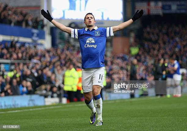 Kevin Mirallas of Everton celebrates scoring his team's first goal during the Barclays Premier League match between Everton and Liverpool at Goodison...