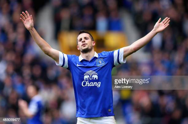 Kevin Mirallas of Everton celebrates scoring the third goal during the Barclays Premier League match between Everton and Arsenal at Goodison Park on...