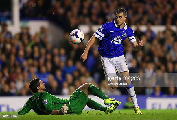 Kevin Mirallas of Everton goes past Julian Speroni of Crystal Palace to score their second goal during the Barclays Premier League match between...
