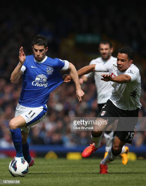 Kevin Mirallas of Everton has his shirt pulled as he attempts to move away from Kieran Richardson of Fulham during the Barclays Premier League match...