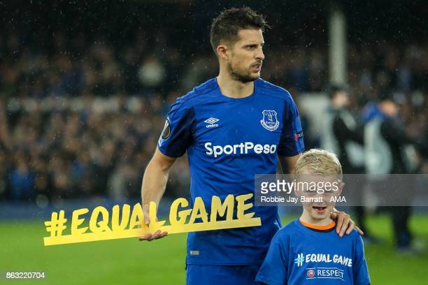 Kevin Mirallas of Everton holds a message which reads Equal Game during the UEFA Europa League group E match between Everton FC and Olympique Lyon at...