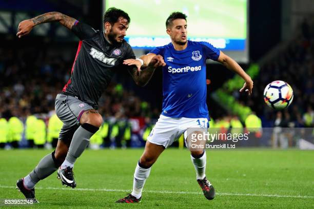 Kevin Mirallas of Everton holds off Savvas Gentsoglou of Hajduk Split during the UEFA Europa League Qualifying PlayOffs round first leg match between...