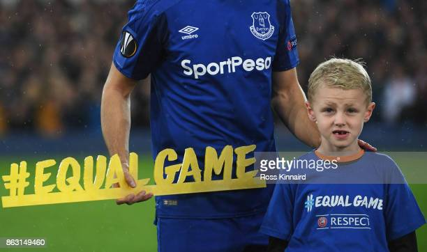 Kevin Mirallas of Everton holds the #equalgame banner alongisde a mascot prior to the UEFA Europa League Group E match between Everton FC and...