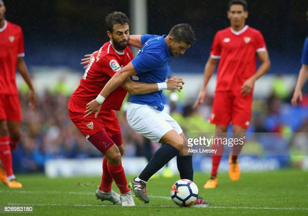 Kevin Mirallas of Everton is brought down for a penalty by Nicolas Pareja of Sevilla during a preseason friendly match between Everton and Sevilla at...