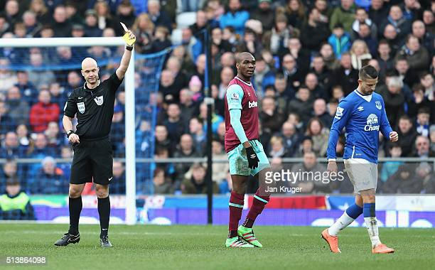 Kevin Mirallas of Everton is shown a red card by referee Anthony Taylor during the Barclays Premier League match between Everton and West Ham United...