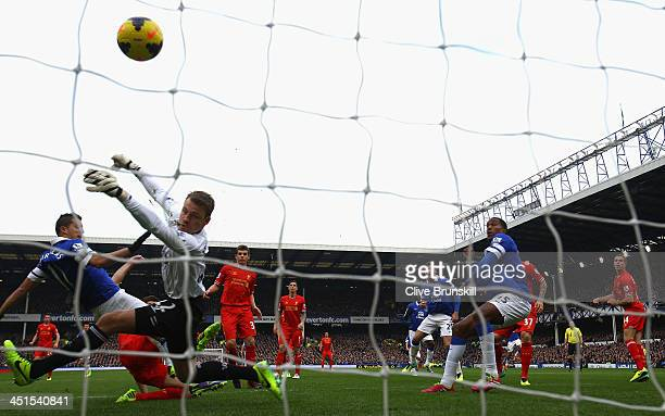 Kevin Mirallas of Everton scores his team's first goal during the Barclays Premier League match between Everton and Liverpool at Goodison Park on...