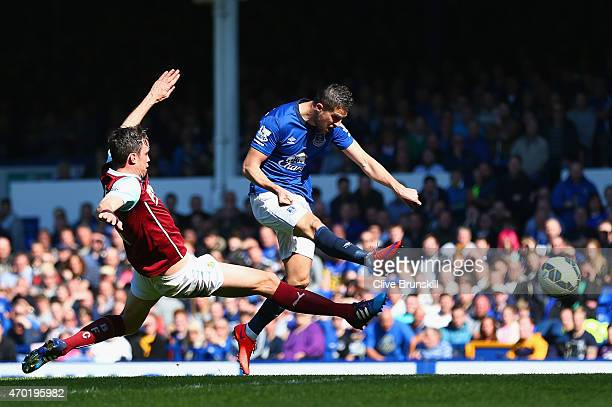 Kevin Mirallas of Everton scores the opening goal during the Barclays Premier League match between Everton and Burnley at Goodison Park on April 18...