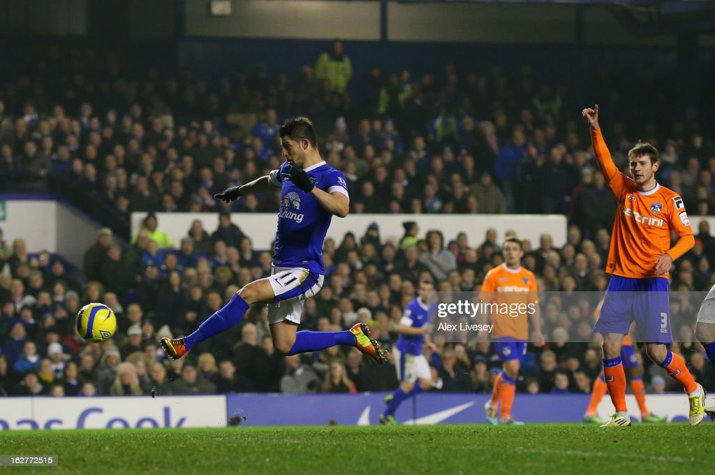 <a gi-track='captionPersonalityLinkClicked' href=/galleries/search?phrase=Kevin+Mirallas&family=editorial&specificpeople=745704 ng-click='$event.stopPropagation()'>Kevin Mirallas</a> of Everton scores the opening goal during the FA Cup fifth round replay match between Everton and Oldham Athletic at Goodison Park on February 26, 2013 in Liverpool, England.