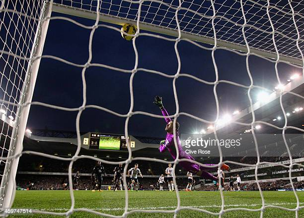 Kevin Mirallas of Everton scores the opening goal past Hugo Lloris of Spurs during the Barclays Premier League match between Tottenham Hotspur and...