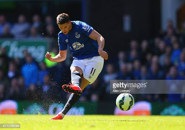 Kevin Mirallas of Everton scores their third goal during the Barclays Premier League match between Everton and Manchester United at Goodison Park on...