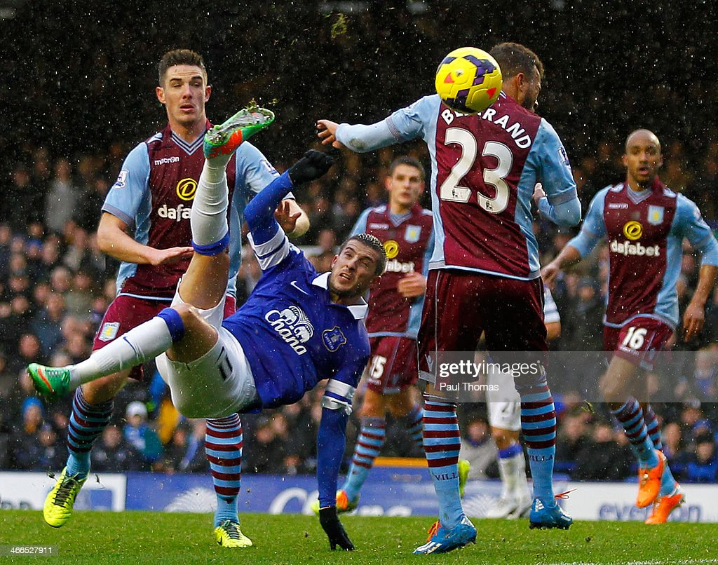 Kevin Mirallas (C) of Everton shoots at goal during the Barclays Premier League match between Everton and Aston Villa at Goodison Park on February 1, 2014 in Liverpool, England.