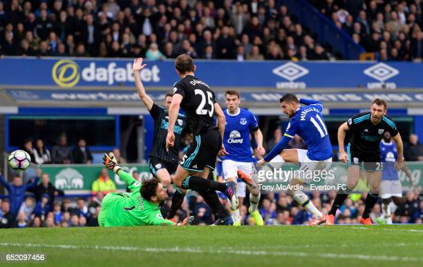 Kevin Mirallas shoots to score during the Premier League match between Everton and West Bromwich Albion at the Goodison Park on March 11 2017 in...