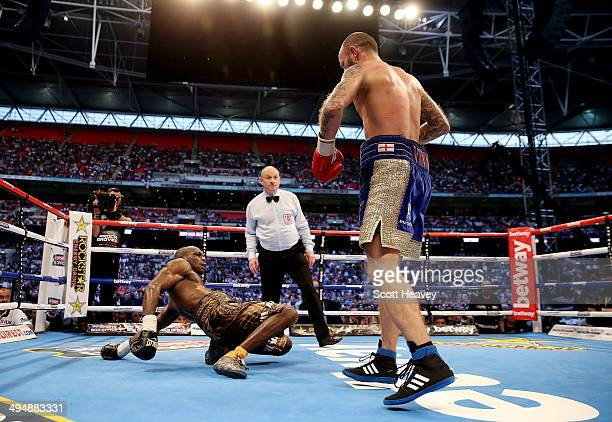 Kevin Mitchell in action with Ghislain Maduma during their IBF World Lightweight Final Eliminator bout at Wembley Stadium on May 31 2014 in London...