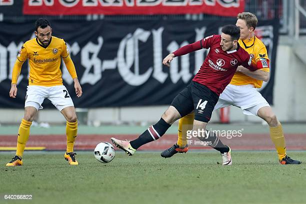 Kevin Moehwald of FC Nuernberg and Marco Hartmann of Dynamo Dresden battle for the ball during the Second Bundesliga match between 1 FC Nuernberg and...